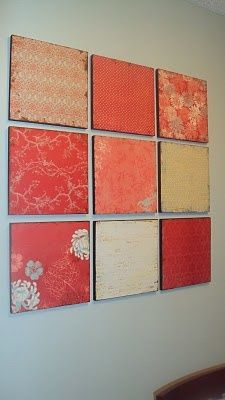 DIY wall decor from scrapbook paper. love the nuances of this color. very pretty - kind of coral/papaya.