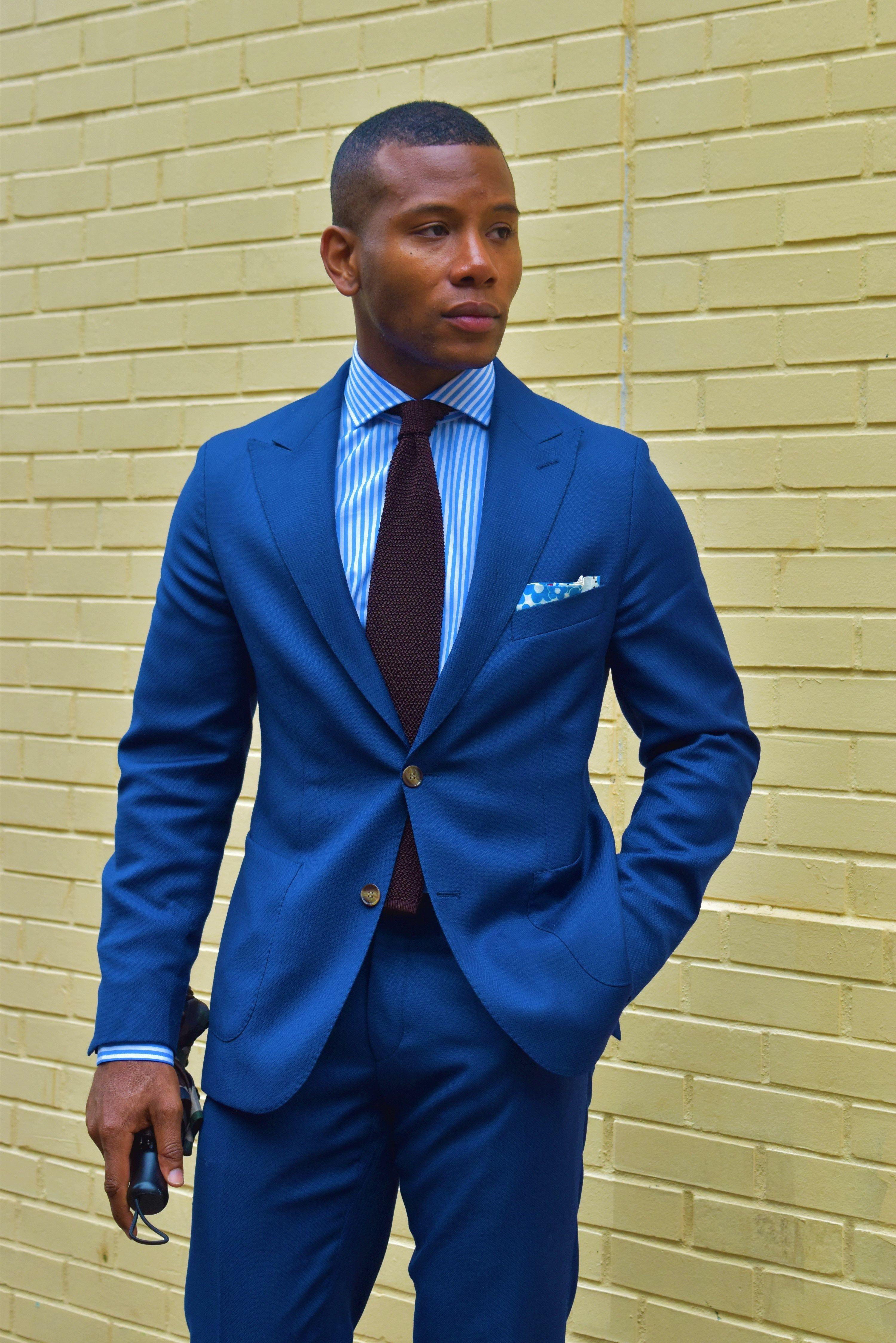 Blue suit + striped dress shirt + pocket square