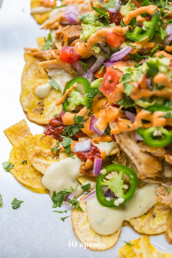 These paleo nachos are epic, aka the best paleo nachos ever. With carnitas, paleo queso, guacamole, pico de gallo, and creamy chipotle sauce!