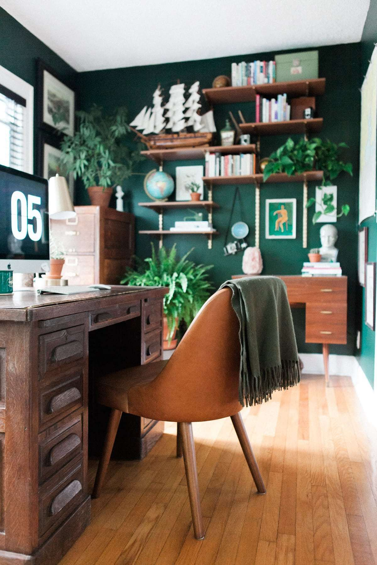 Bring color and masculine design to your home office with a bit of emerald green and plenty of natural wood furniture check out this space for yourself