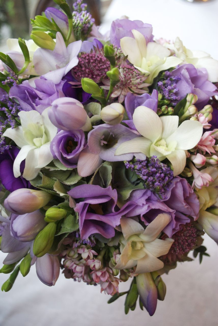 Bridal bouquet of freesia lisianthus astrantia orchids and beautiful fresh flowers for wedding bouquets buttonholes corsages and flower girl wands we can create gorgeous hand tied bouquets in vintage style izmirmasajfo Choice Image