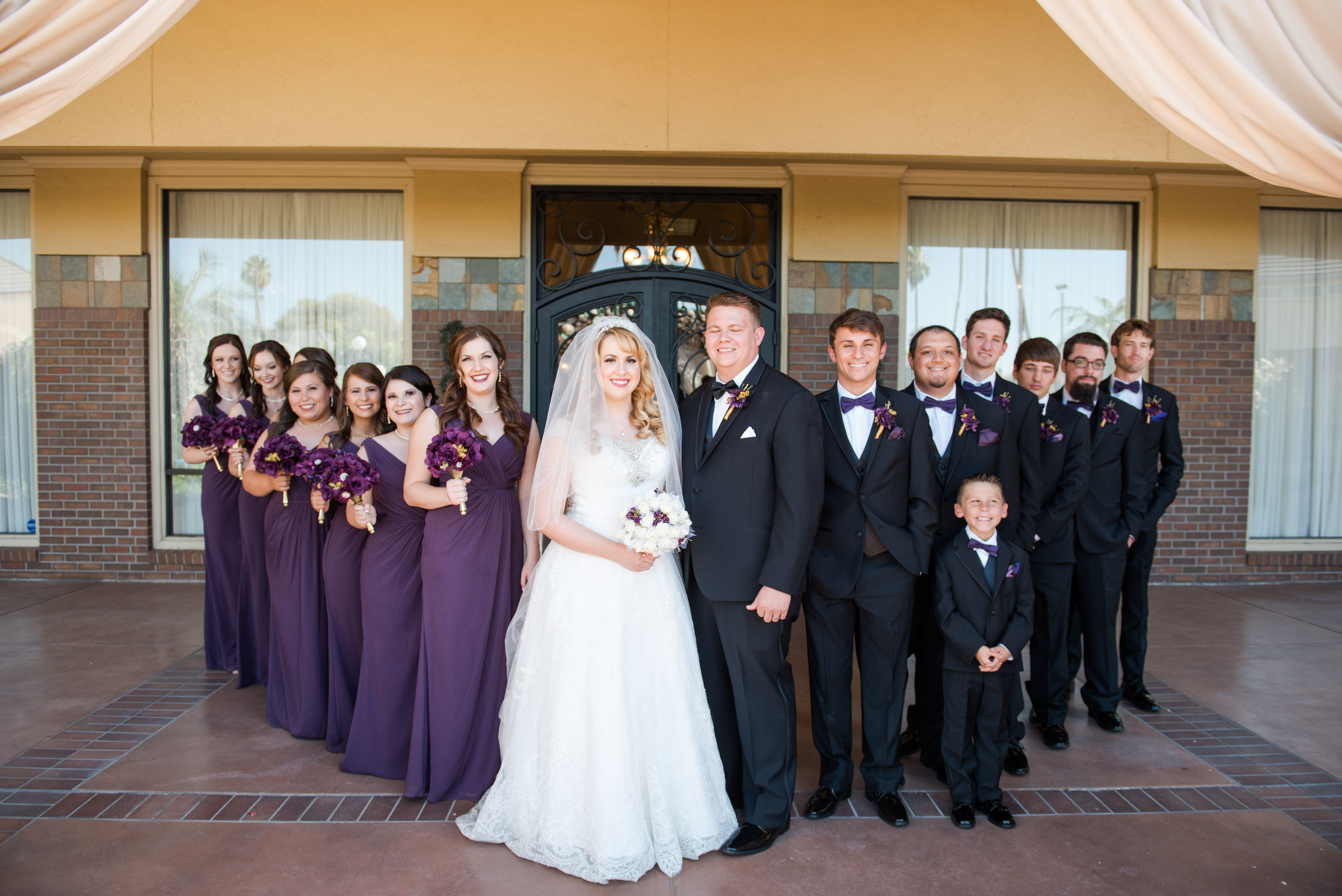 Bridal party dressed in plum and black |