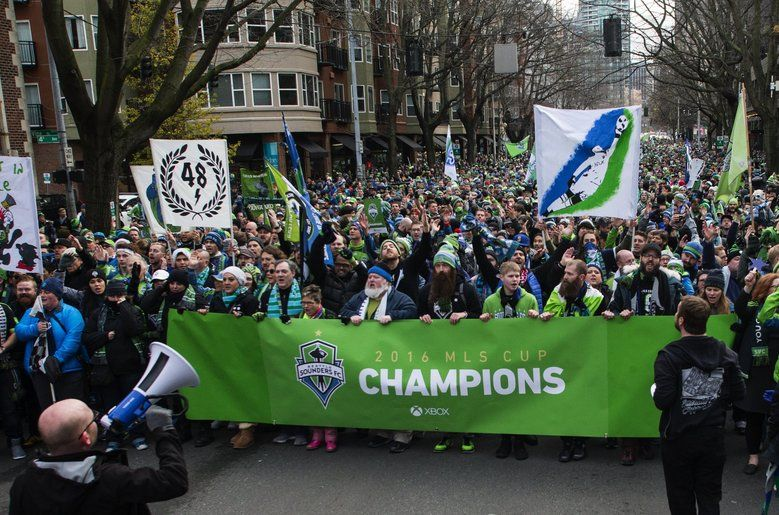 The Emerald City Supporters March Down 4th Avenue Holding A Champions Banner During A Sounders March And Rally To Celebrate Th Mls Cup Sounders Victory Party