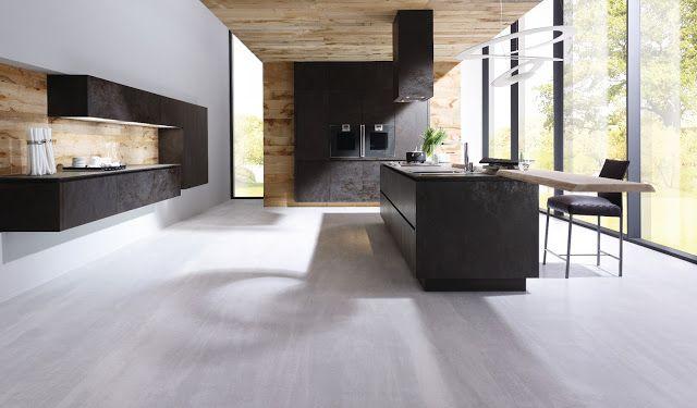 Cuisine design céramique et bois avec îlot et meubles suspendu - alno küchen grifflos