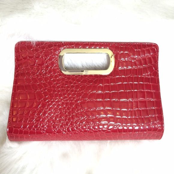"""Cherry Red Clutch!  BRAND NEW! Cherry red faux alligator  clutch with silver handle engraved with NY&C's logo. Inside has a small zippered compartment for lipstick  and is perfectly clean! 12.5"""" wide X 8.5"""" tall X 3"""" thick. Identical on both sides; NO FLAWS! Brand New, Never Used! New York & Company Bags Clutches & Wristlets"""