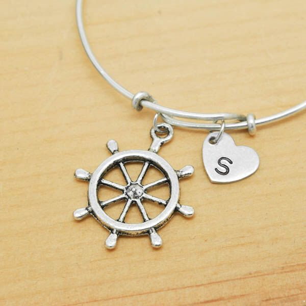 A personal favourite from my Etsy shop https://www.etsy.com/hk-en/listing/219570936/anchor-wheel-bangle-sterling-silver