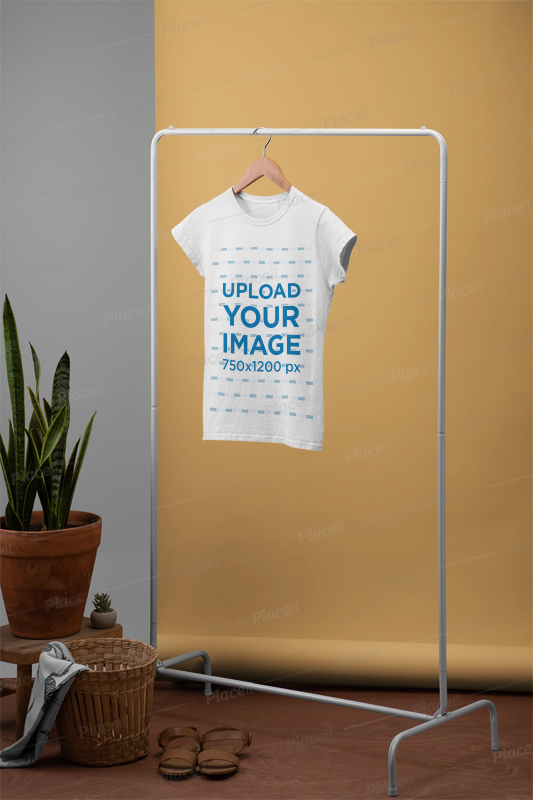 Download Placeit Women S T Shirt Mockup Hanged From A Rack Next To A Plant Pot And A Basket Shirt Mockup Tshirt Mockup T Shirts For Women