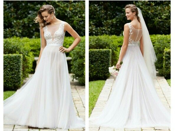 Illusion mesh top wedding dress with lace appliques and a flowing