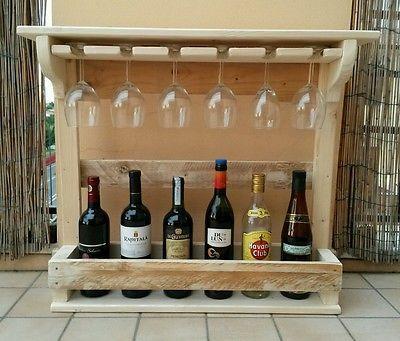 Cantinetta porta bottiglie e porta calici arredamento for Idee per arredare enoteca