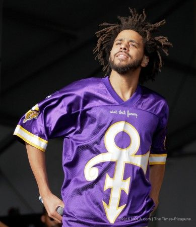 J.Cole performs on the Congo Square Stage during the third day of the New Orleans Jazz Fest at the Fair Grounds Sunday, April 24, 2016.