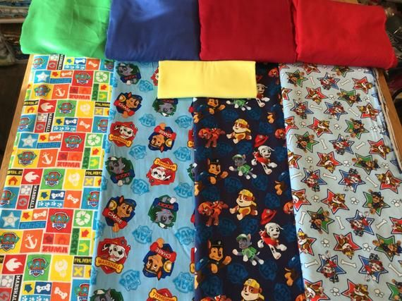 Toddler Blanket, Crib Blanket, Children Quilt, NEW PAW PATROL fabric prints, 4 prints available, 44x54, all cotton, 3 layer construction - Toddler blanket, Crib blanket, Quilts, Printing on fabric, Character blankets, Blanket - quilt  This all cotton large toddler blanket is perfect for your Little One   Made with 100% cotton fabric, 100% cotton flannel and 100% organic unbleached cotton batting  This large toddler blanket is approximately 44x54 in size  This listing has 3 Character fabric prints available   1) Paw Patrol  characters jumping on dark blue background  cotton  1 available 2) Paw Patrol  characters in shields on light blue background  cotton  2 available 3) Paw Patrol  characters in Stars bones paws on Light blue background  cotton flannel  2 available 4) Paw Patrol  character names and logos in a patchwork print  cotton flannel  2 available  The printed cotton fabric has all of the characters on it as seen in the listed picture  Please choose the character fabric print (by number) you would like for your blanket and the color of solid cotton flannel you would like too!  The cotton batting used will keep your toddler warm and cozy during nap and sleep time  This blanket has a nice weight to it   Easy wash and dry, no bleach needed  No need to hang dry  This blanket was made to be used and washed frequently   More character blankets to come! If you have a special character you would like a blanket made out of please message me and I will do my best to fill your order needs   I can't say enough about this blanket, it is perfect for busy parents and it washes up great! Both boys and girls love these blankets!