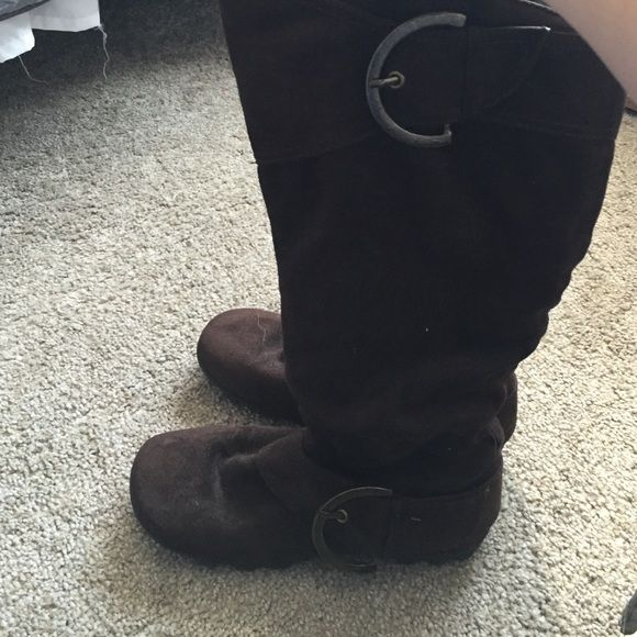 Brown boots These have never been worn. Brown mid calf boots with buckles on the sides. Inside of boot has a zipper. Maurices Shoes Winter & Rain Boots