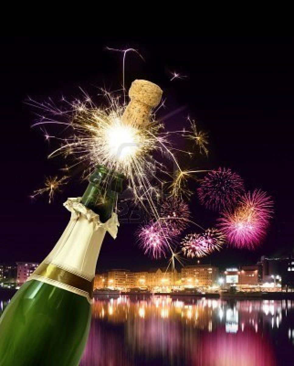 Champagne bottle cork popping with sparkling New Year
