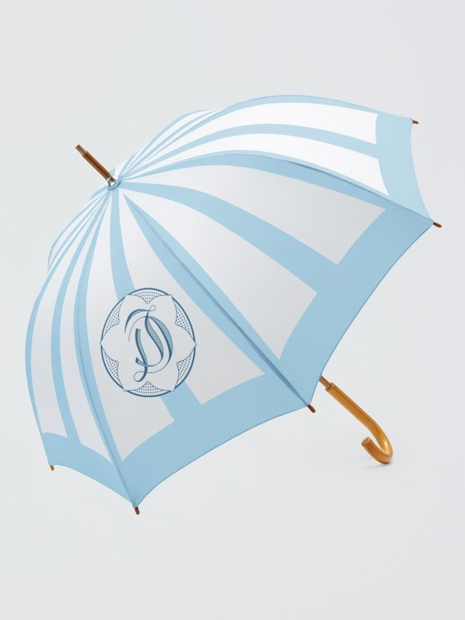 Rain, rain, don't go away! Stay—if only to offer an excuse for pulling out our stylish Draper James logo umbrella.  Please note this item is not eligible for gift wrapping.