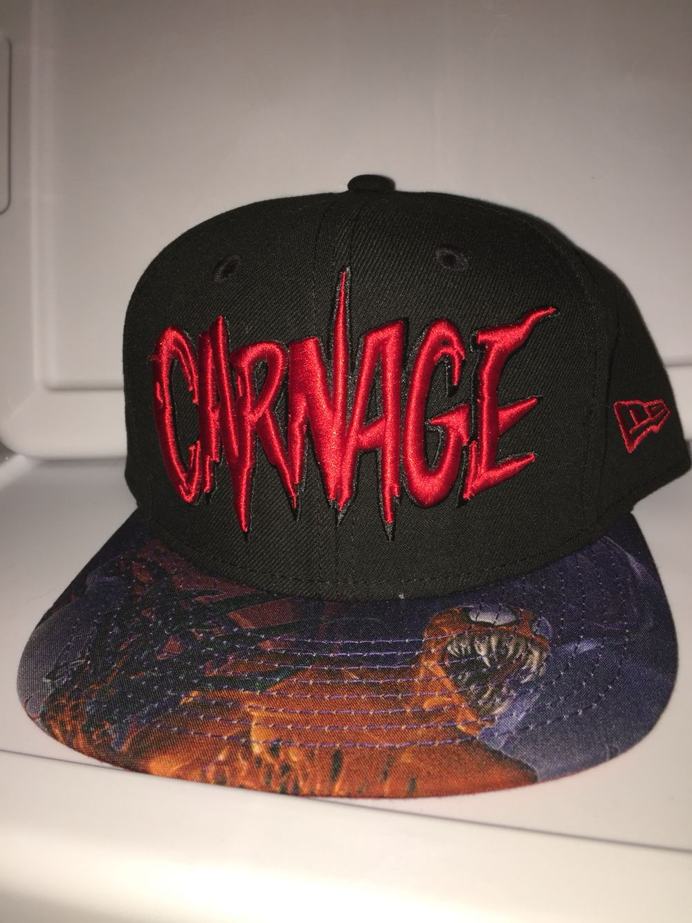 New era marvel snapback Carnage with Carnage character on brim red under  brim with small carnage head on the side fa4c6b20ada