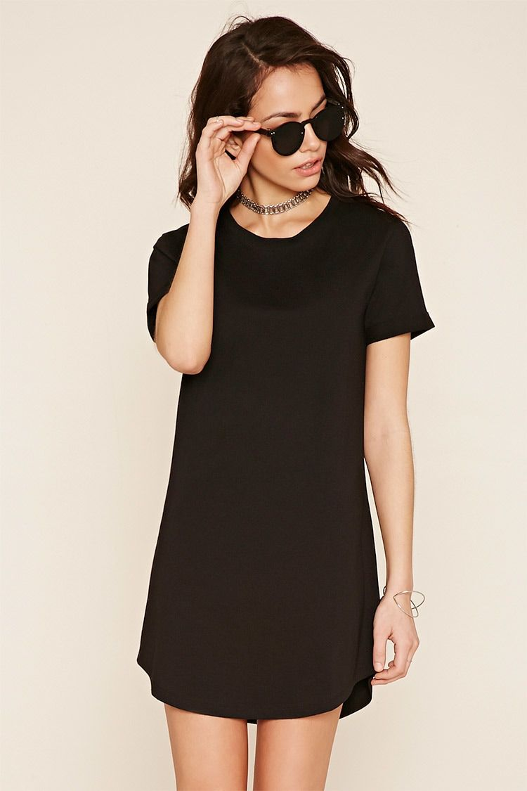 A knit T-shirt dress with cuffed short sleeves, a rounded hem, and a round neckline.