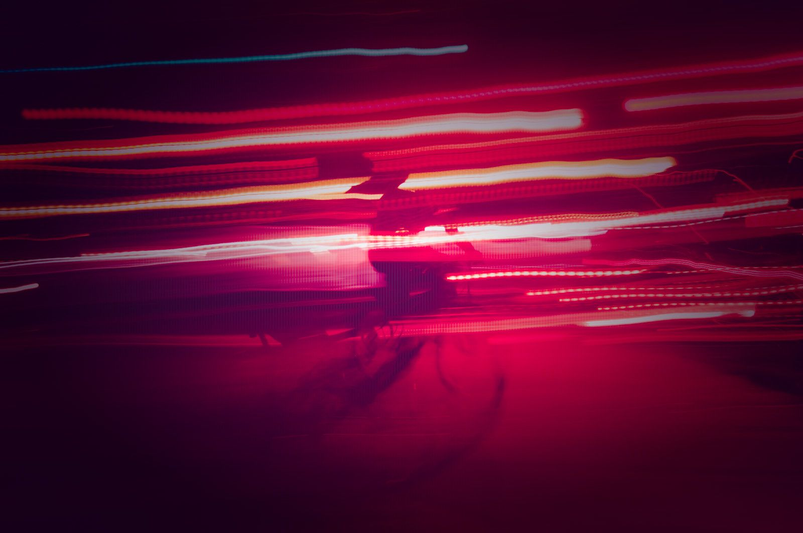 Abstract 5530. Photo of a biker in them middle of the night in downtown Toronto.