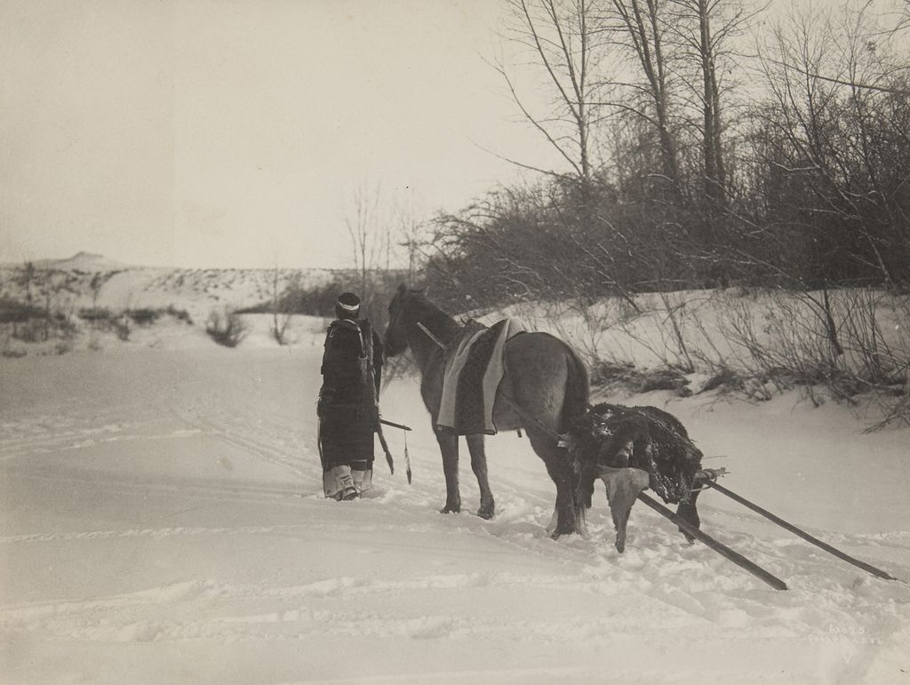 Native american with horse pulling travois httpsfarm3