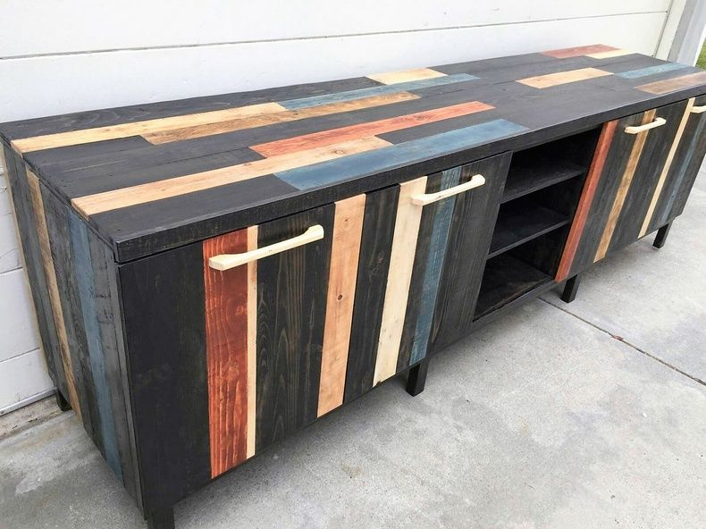 With pallet wood you can pay with your creative imagination and your aesthetic instincts with freedom. This pallet wood media cabinet is built by dismantling the pallet wood and making fine planks of wood. You will have to paint them in different colors and then joining them all, nailing them into a one piece of this wooden cabinet cum TV stand.