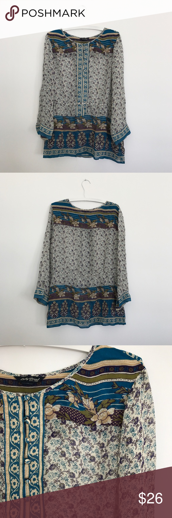 """Lucky Brand floral sheer tunic popover peasant top Lucky Brand savannah gypsy top. floral semi-sheer tunic popover top. Boho. Loose elastic cinched waist. Button neckline. Sheer fabric. Sleeve slightly roll up. Button at wrist. Measure flat: pit to pit 24"""", back length 27.5"""", shoulder to wrist 21.5"""". 100% rayon but tag cut out. Please let me know if you have any questions. Lucky Brand Tops Blouses"""