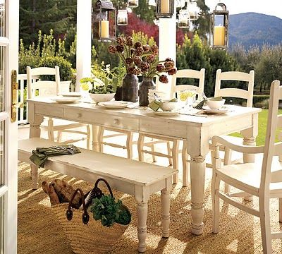 Painted Farmhouse table, chairs and bench on porch Dining