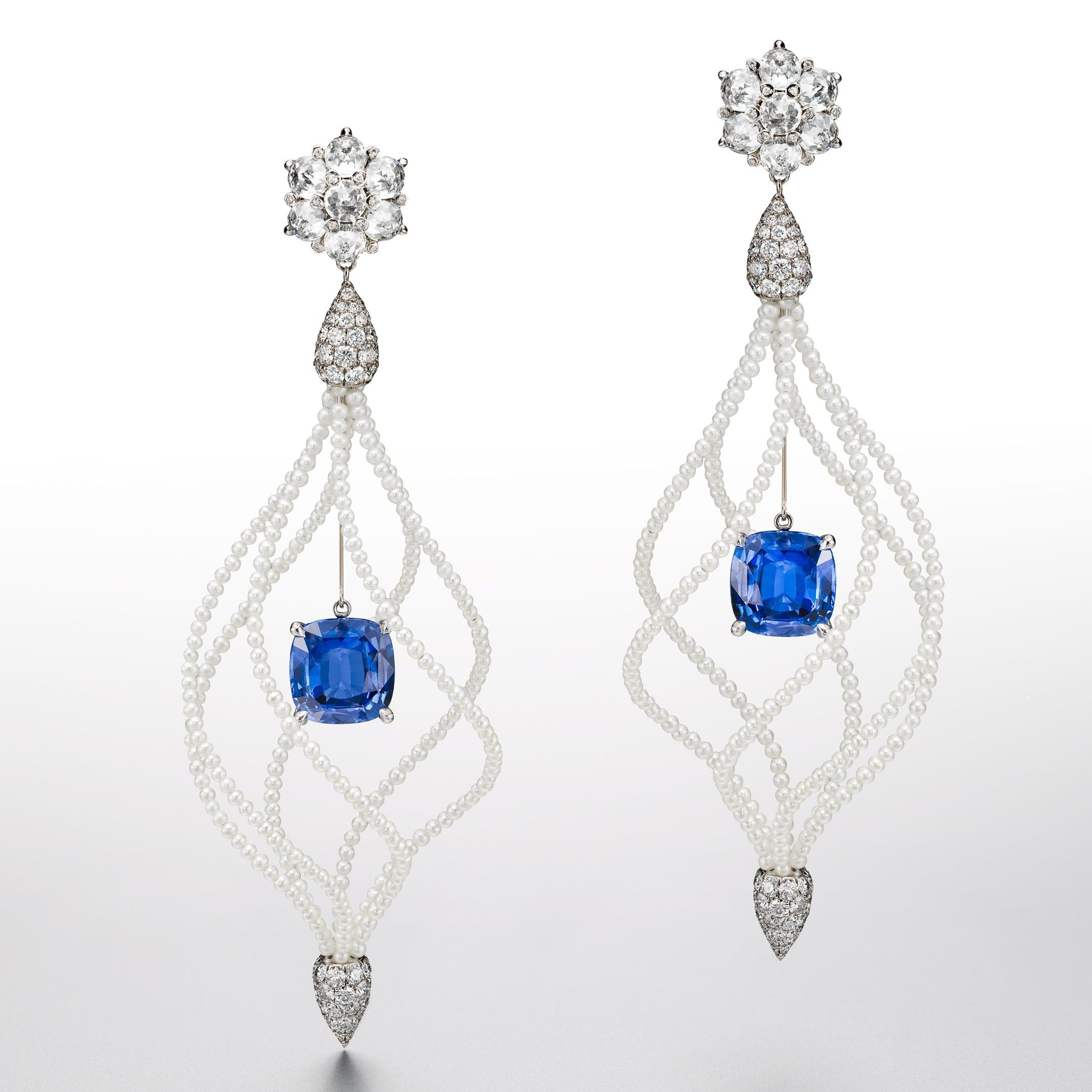 Suzanne Syz Lady Hamilton earrings in white gold and titanium set with Ceylan sapphires, domed crown diamonds and pearls. Courtesy of Suzanne Syz.