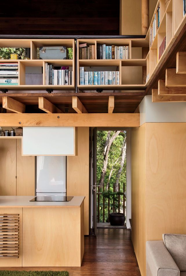Modern small space in New Zealand with shelving and lofted sleeping ...