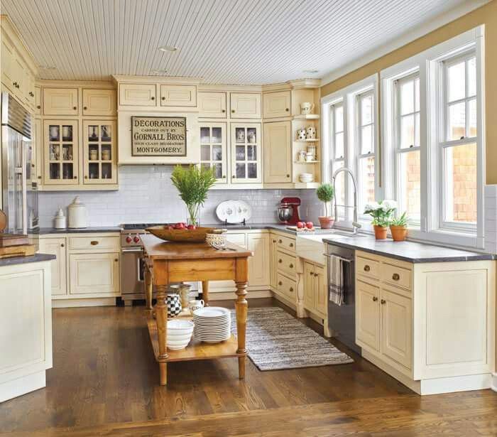 love the pale yellow and black countertop. also the ...
