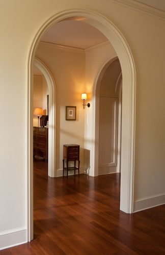 With these arched door ways thicker crown molding for Arch door design