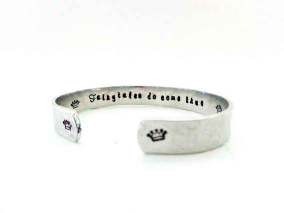 "This subtle ""fairytales do come true"" cuff."