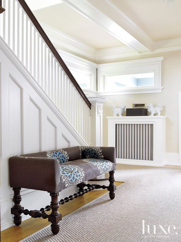 The original staircase was redone during the renovation in a spirit true to the craftsman home's original aesthetic. A Stark rug from George...