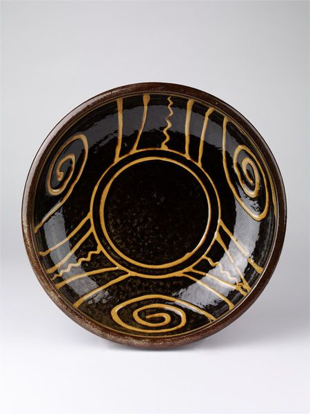 1939 Cardew, Michael, born 1901 - died 1983, Earthenware, white slip decoration on black under an amber glaze