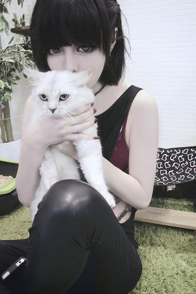 I held a kitty up to my chest and smiled as i felt it's fur. How soft it was and i cuddled it and giggled.