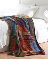This beautiful throw uses the same log-cabin design 6 times in different color combinations. (LionBrand.com)