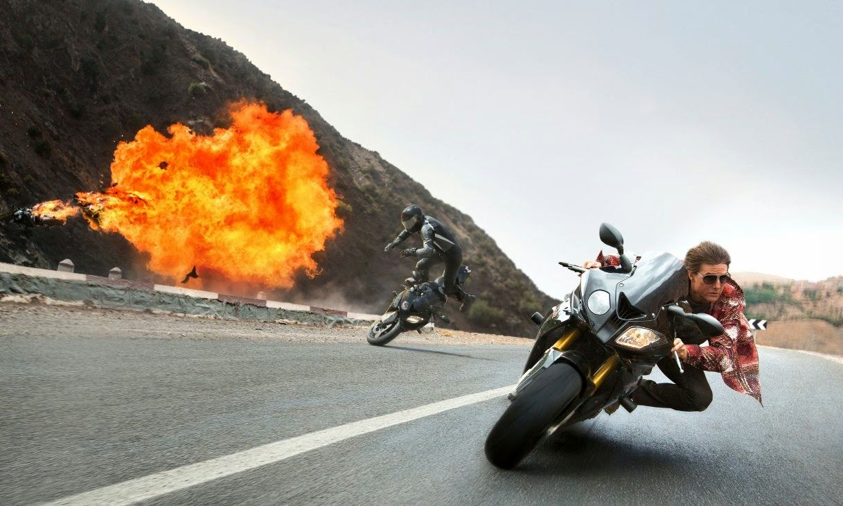 Tom Cruise riding a bike in Mission Impossible Rogue Nation