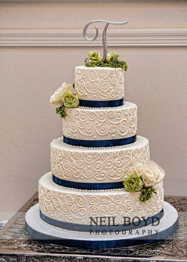 The Classic White Tiered Wedding Cake With Navy Blue Ribbon And