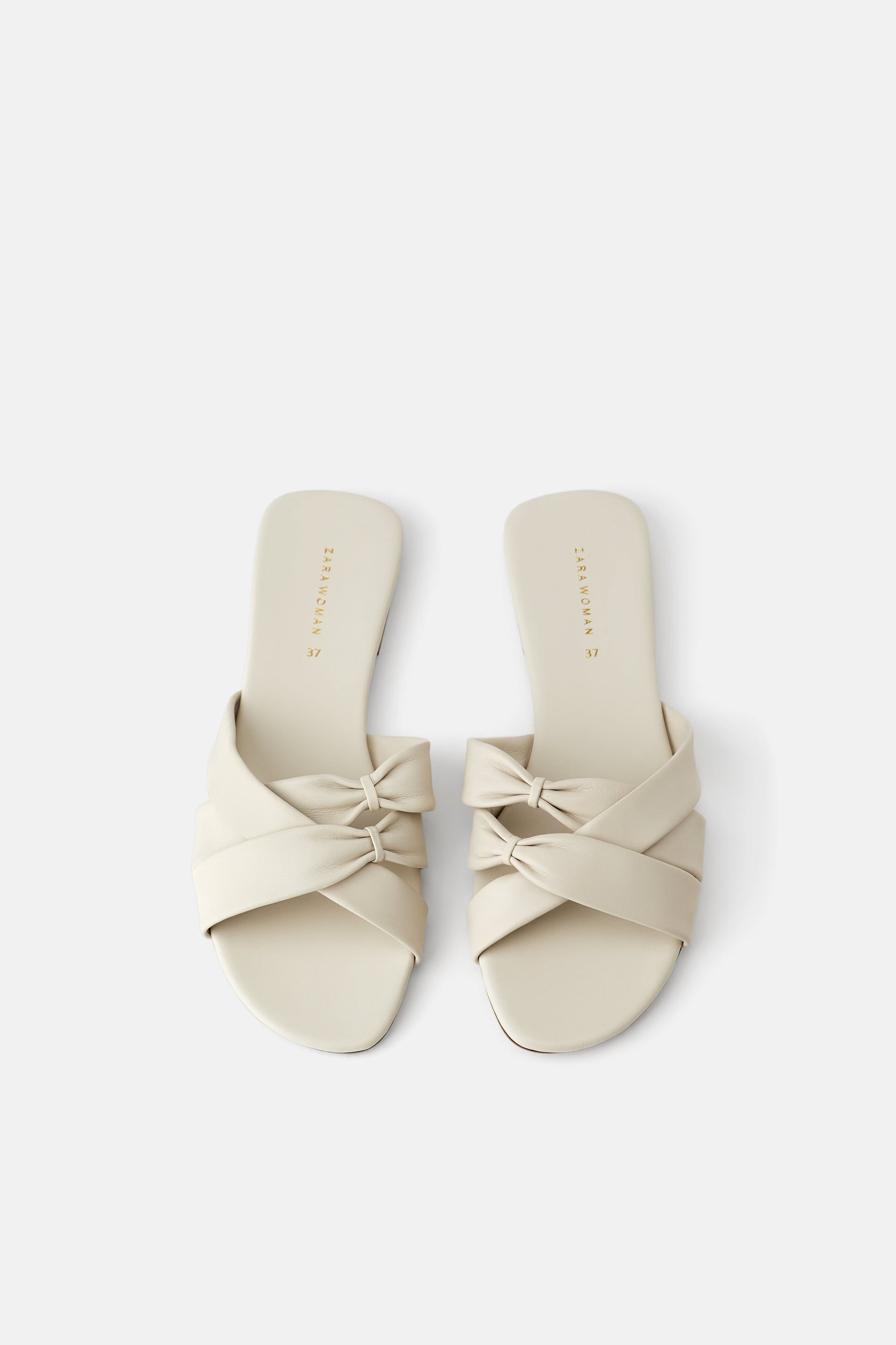 33539ccfbdc FLAT LEATHER SANDALS WITH CRISS - CROSS STRAPS-View all-SHOES-WOMAN