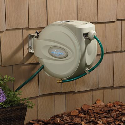 This Hose A Matic Wall Mount Hose Reel Sets Itself Apart From The Rest By Giving You Many U Retractable Garden Hose Reel Garden Hose Reel Hose Holder