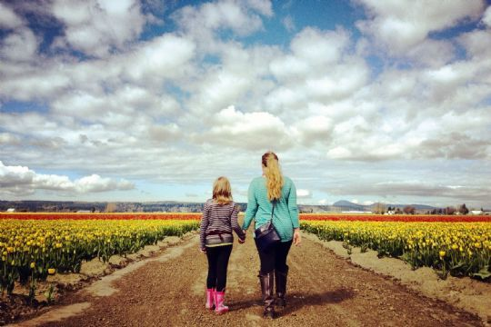 My daughter and I walking through the tulip fields... #photocontest