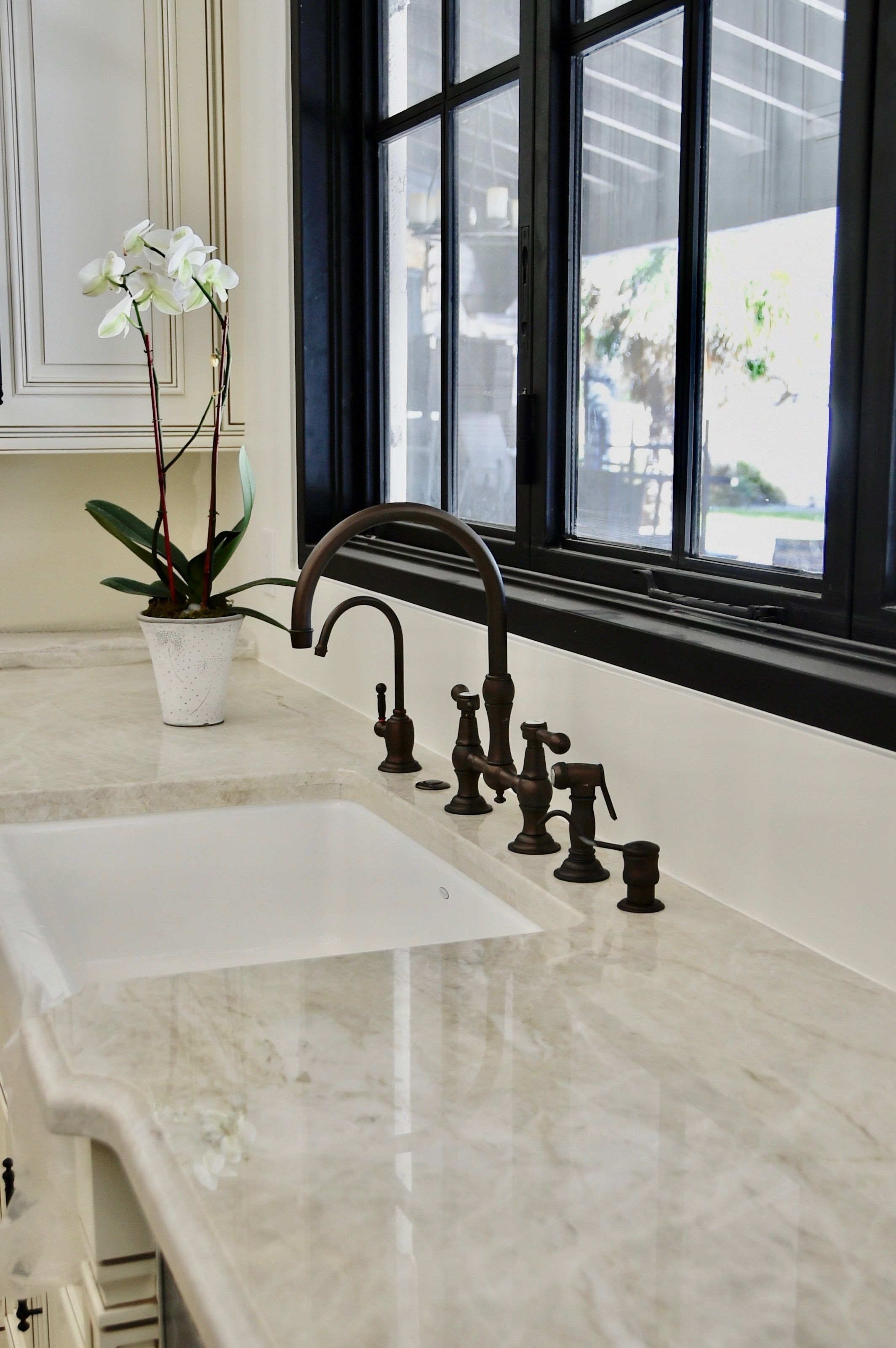 Kitchen window without sill  kitchen remodel  taj mahal countertops  luxury remodels company