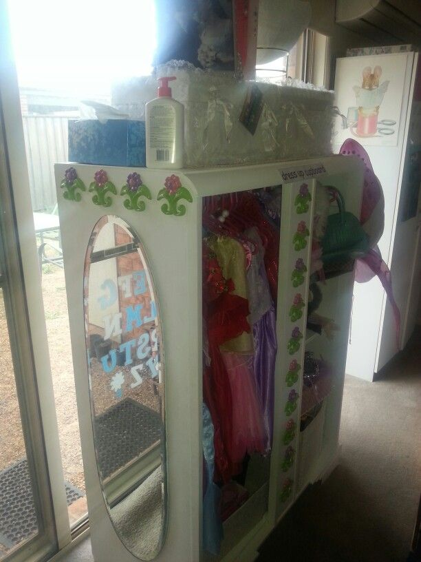 Dressup wardrobe which I upcycled from an ugly old vintage nursery wardrobe. All the girls' dressup costumes, shoes, bags and access all tidy in one place and a mirror ti admire their stylin combos when they're done ♡