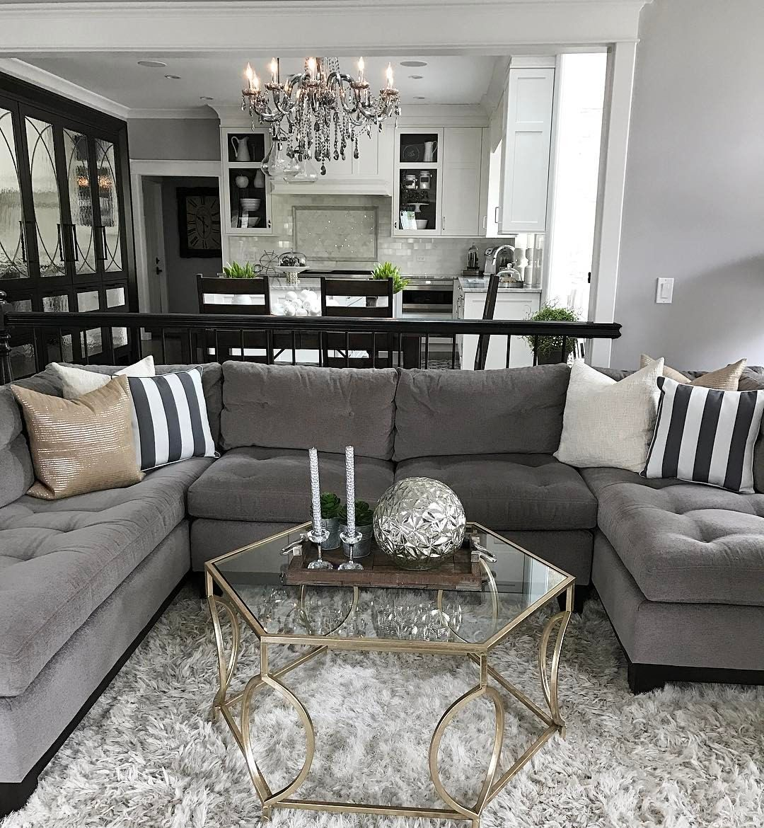 Change up the gray couch with and chic black and white - Black brown and white living room ...