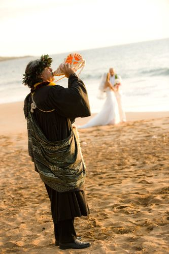 Traditional hawaiian conch shell greeting to signify the beginning traditional hawaiian conch shell greeting to signify the beginning of the ceremony killer maui wedding m4hsunfo