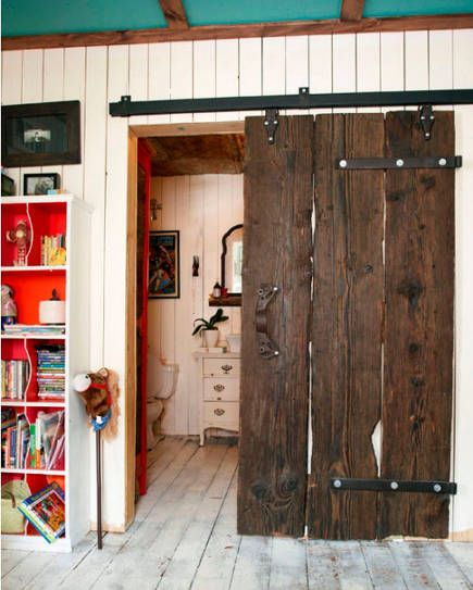Vintage restored natural wood sliding interior barn door in an Ontario farmhouse \u2013 The Marion House & Vintage restored natural wood sliding interior barn door in an ...