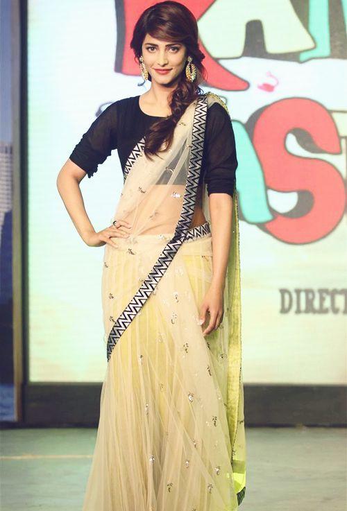 Sruthi Hassan in yellow net half saree