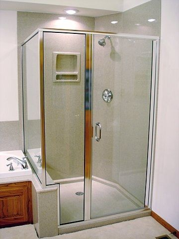Onyx shower with glass surround and panels to the ceiling. The ...