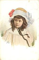 half length study of girl wearing fancy hat with bow, right, & red flowers, left, secured by ribbons, faces front, looks half left