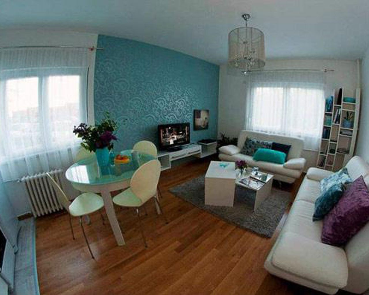 Cute living room ideas for apartments - Interior Beautiful Small Apartment Living Room Design Layout With Blue Ocean Wall Colour And Confort Cream Sofa And Blue Dining Table Contemporary Apartment