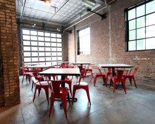 Mission Taco Soulard, by SPACE Architecture and Design. Garage door seating.