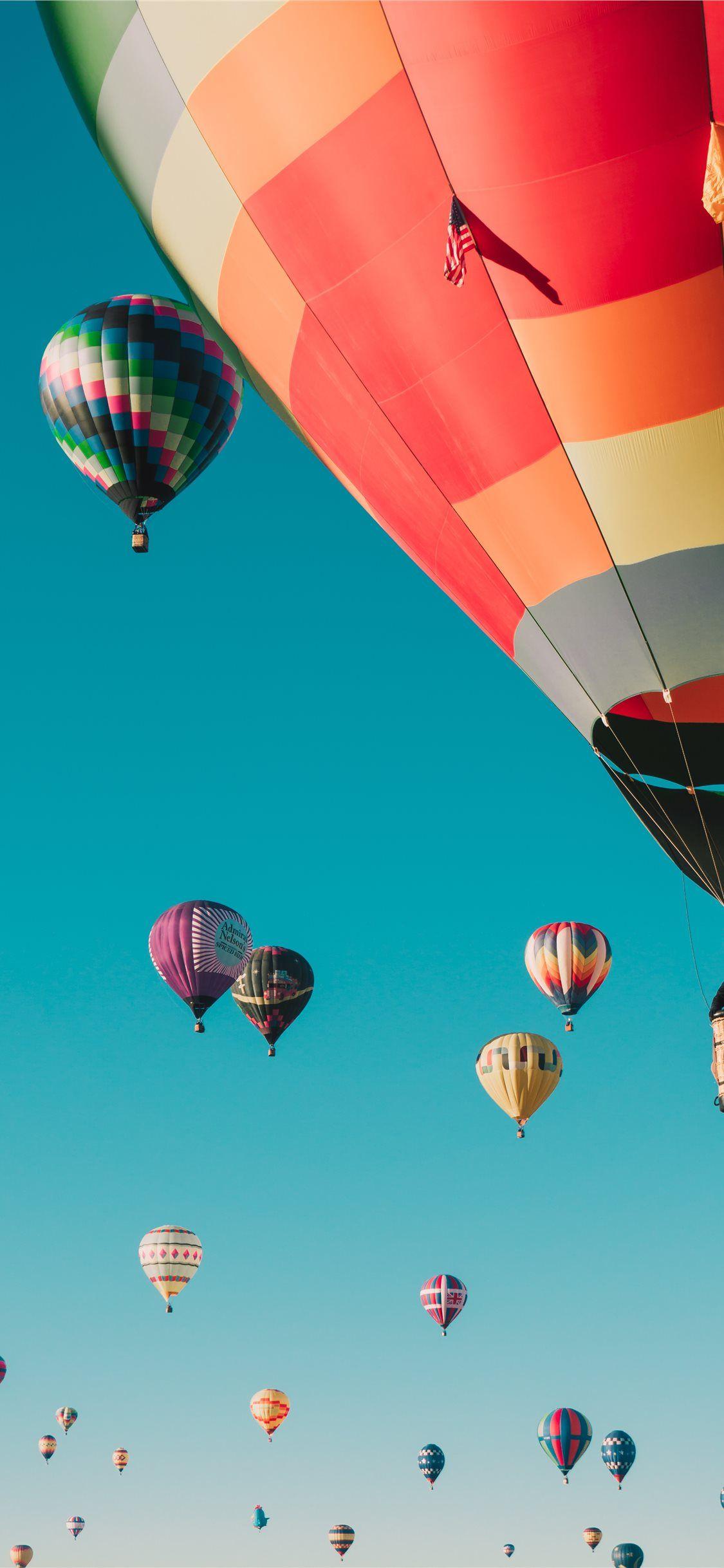 Hot Air Balloons Under Blue Sky Balloon Sky Flag Albuquerque Unitedstates Iphone11wal Iphone 11 Wallpaper Hot Air Balloon Wallpaper Air Balloon Wallpaper